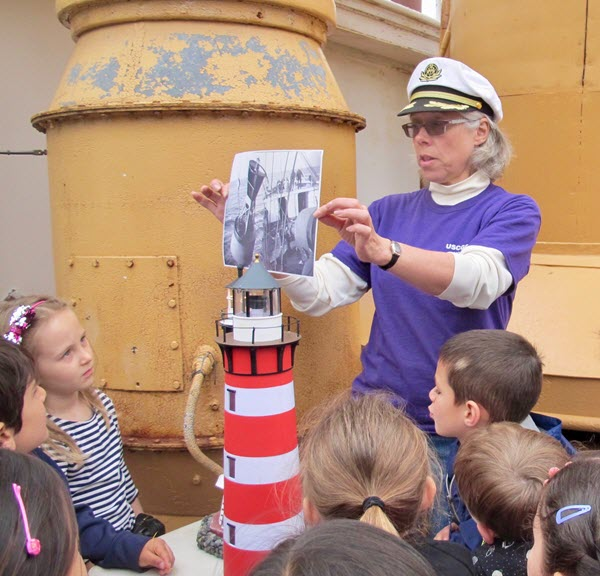 Museum director Mary Habstritt tells the children about the ship's work as a U.S.C.G Lighthouse Tender from 1933 to 1972.